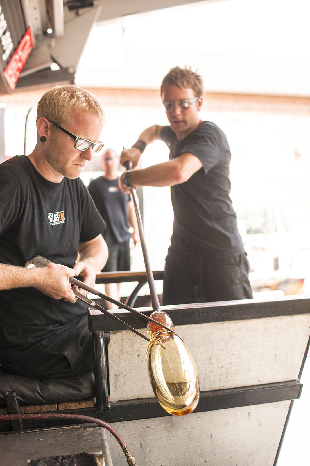 Gaffers Adam Holtzinger and Chris Rochelle work on a prototype by designers Chris and Dominic Leong