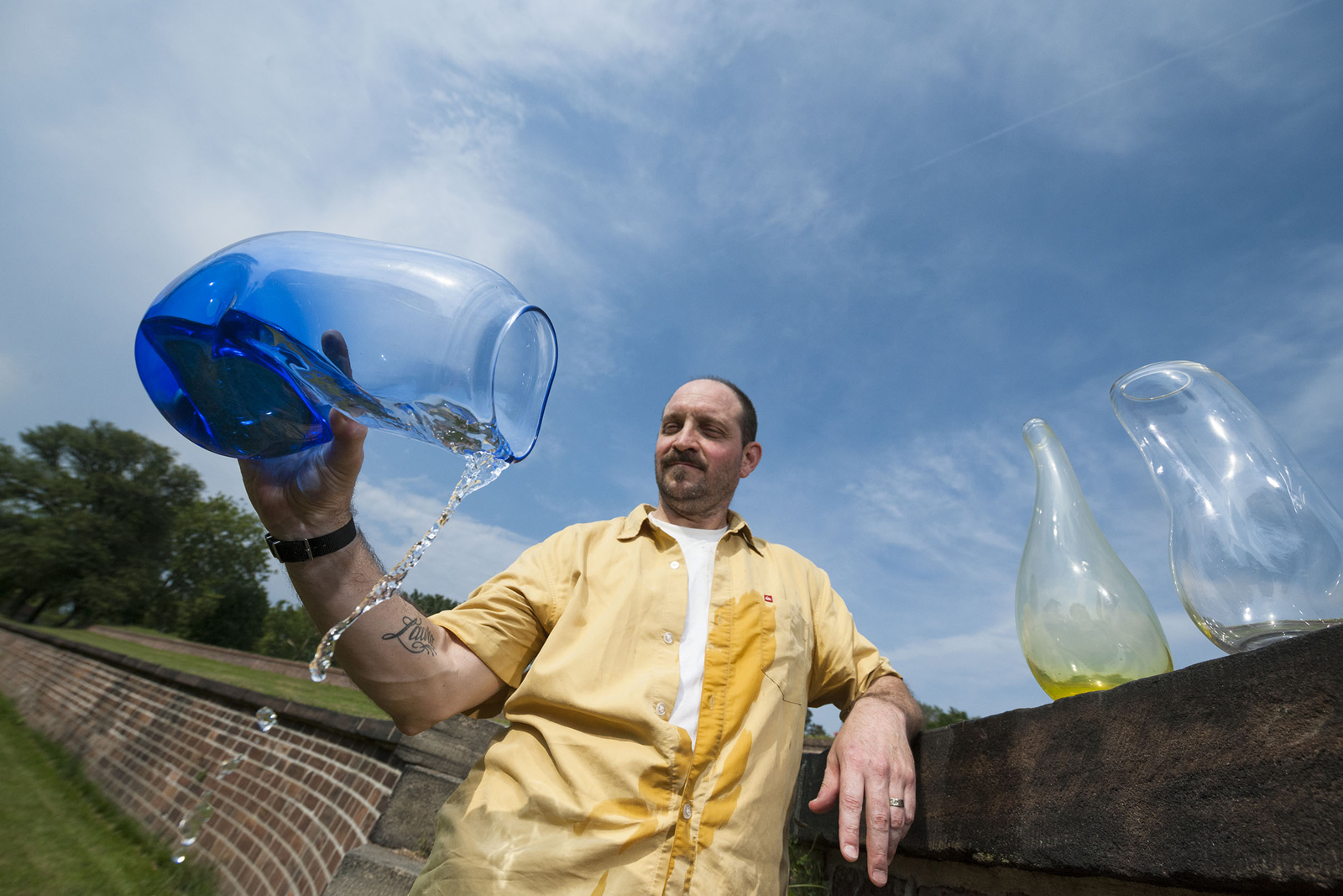 "Designer James Victore with his ""Drunken Vessel"" prototypes for GlassLab on Governors Island"