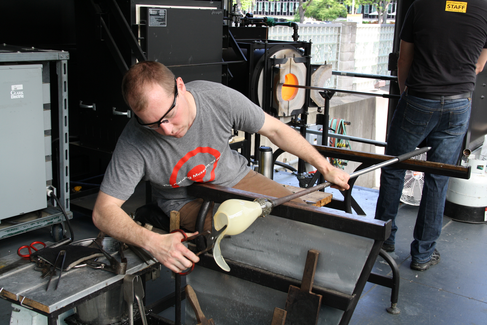 Gaffer Eric Meek works with designer Sigga Heimis in a GlassLab session in Corning, May 2012