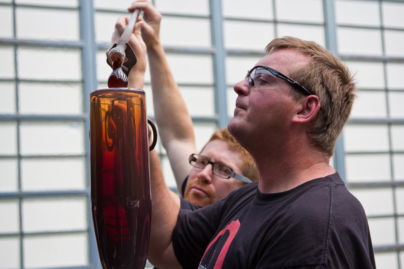 Gaffers George Kennard and Dane Jack work with Masamichi Udagawa and Sigi Moeslinger at GlassLab in Corning