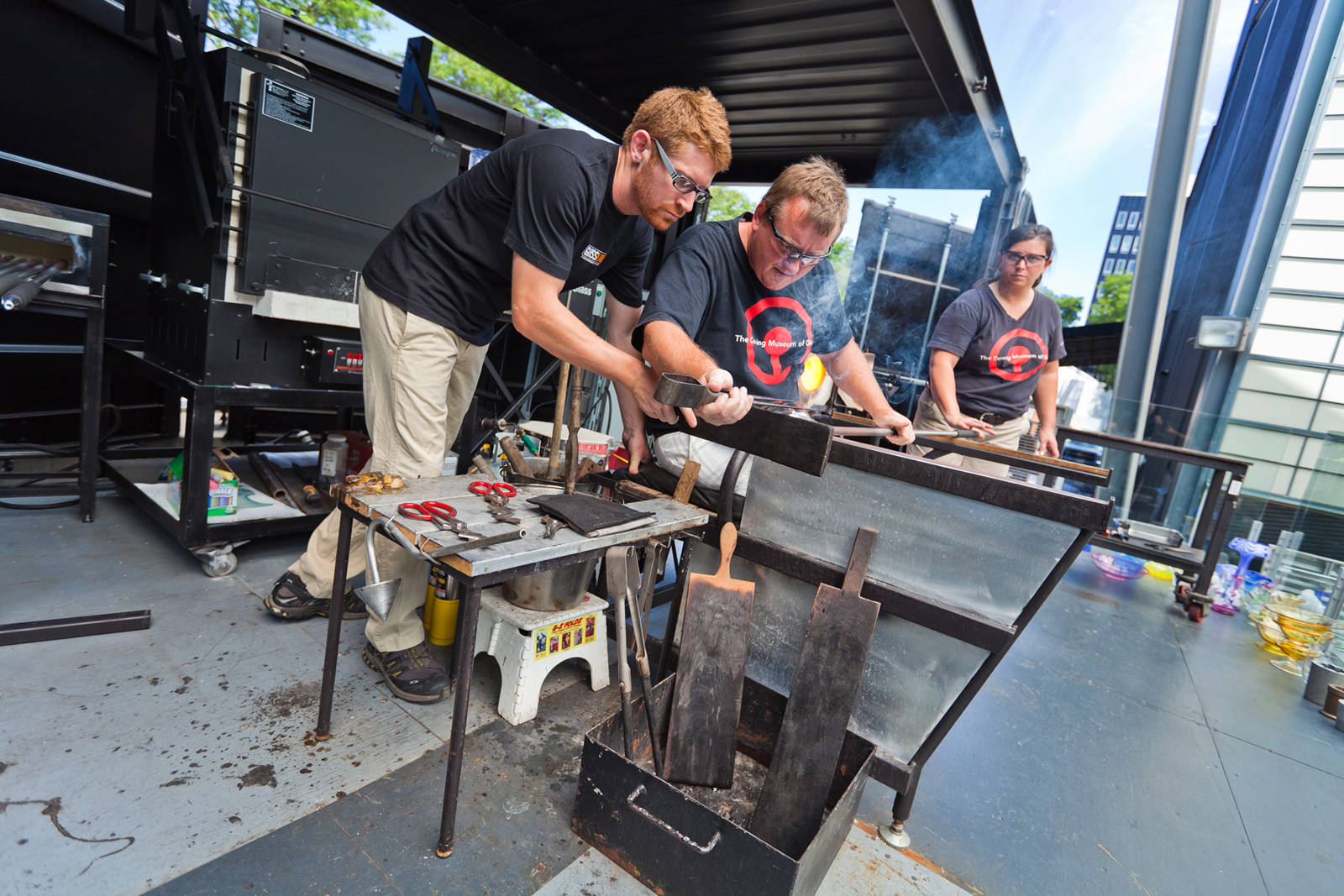 Gaffers George Kennard, Dane Jack, and Catherine Ayers work with Masamichi Udagawa and Sigi Moeslinger at GlassLab in Corning
