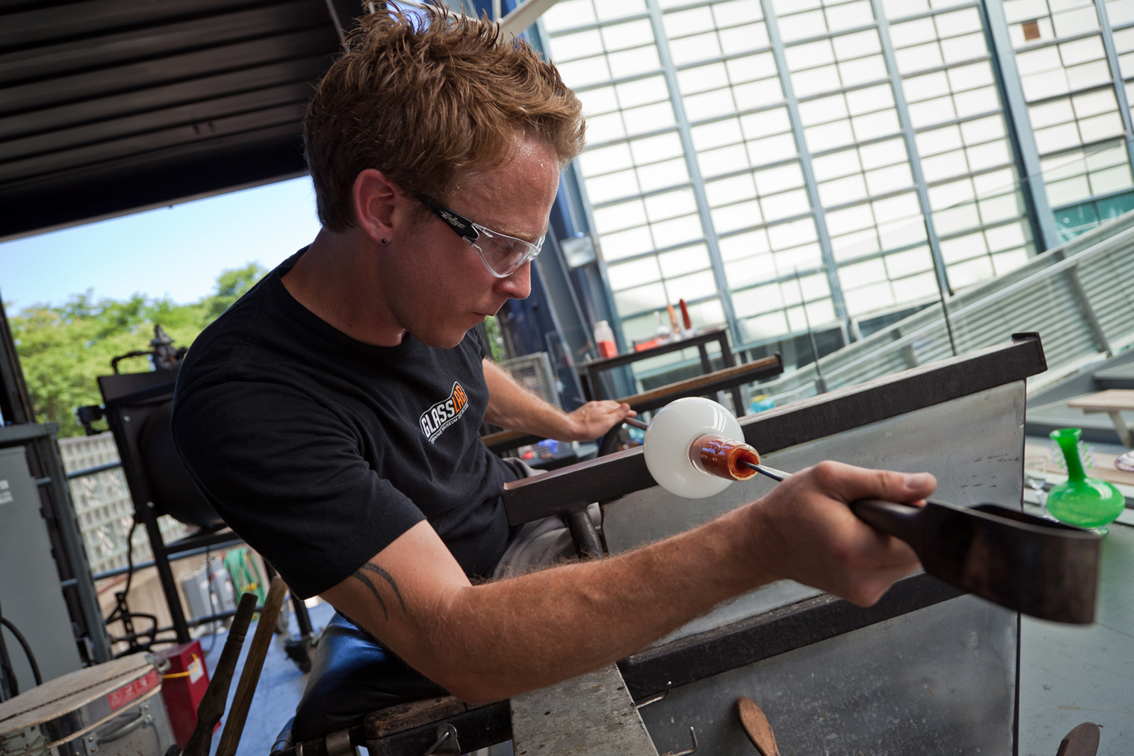 Gaffer Chris Rochelle works with designer Marc Thorpe at GlassLab in Corning
