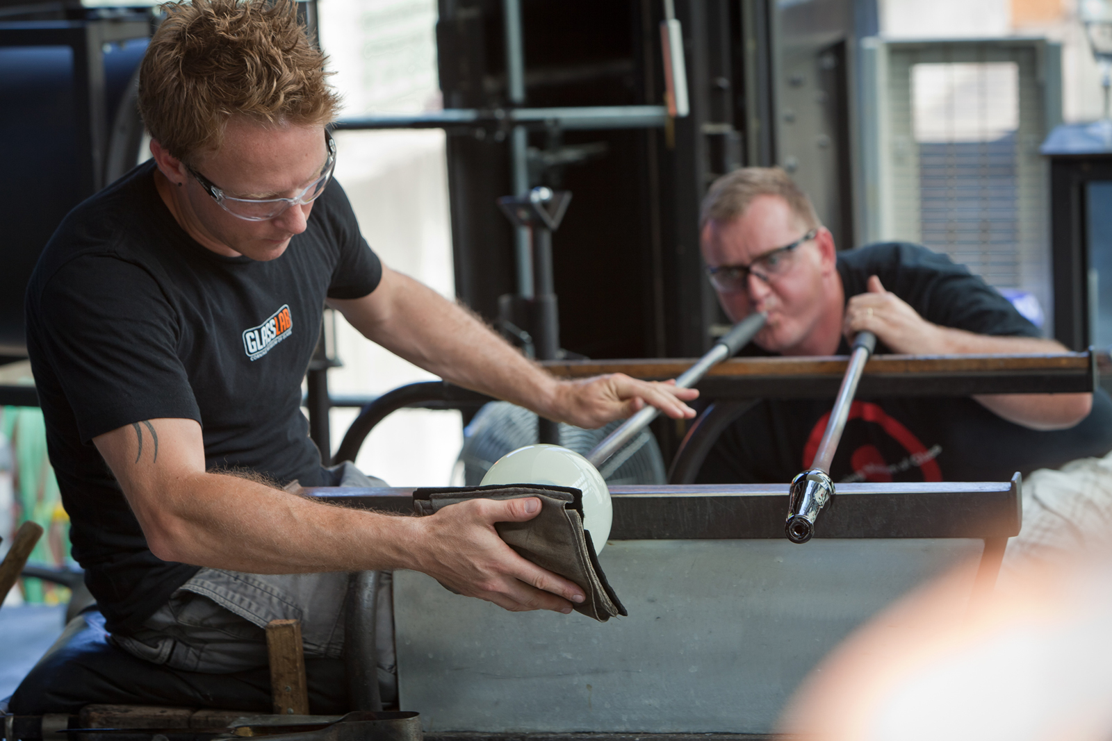 Glassmakers Chris Rochelle and George Kennard work with designer Marc Thorpe during GlassLab in Corning