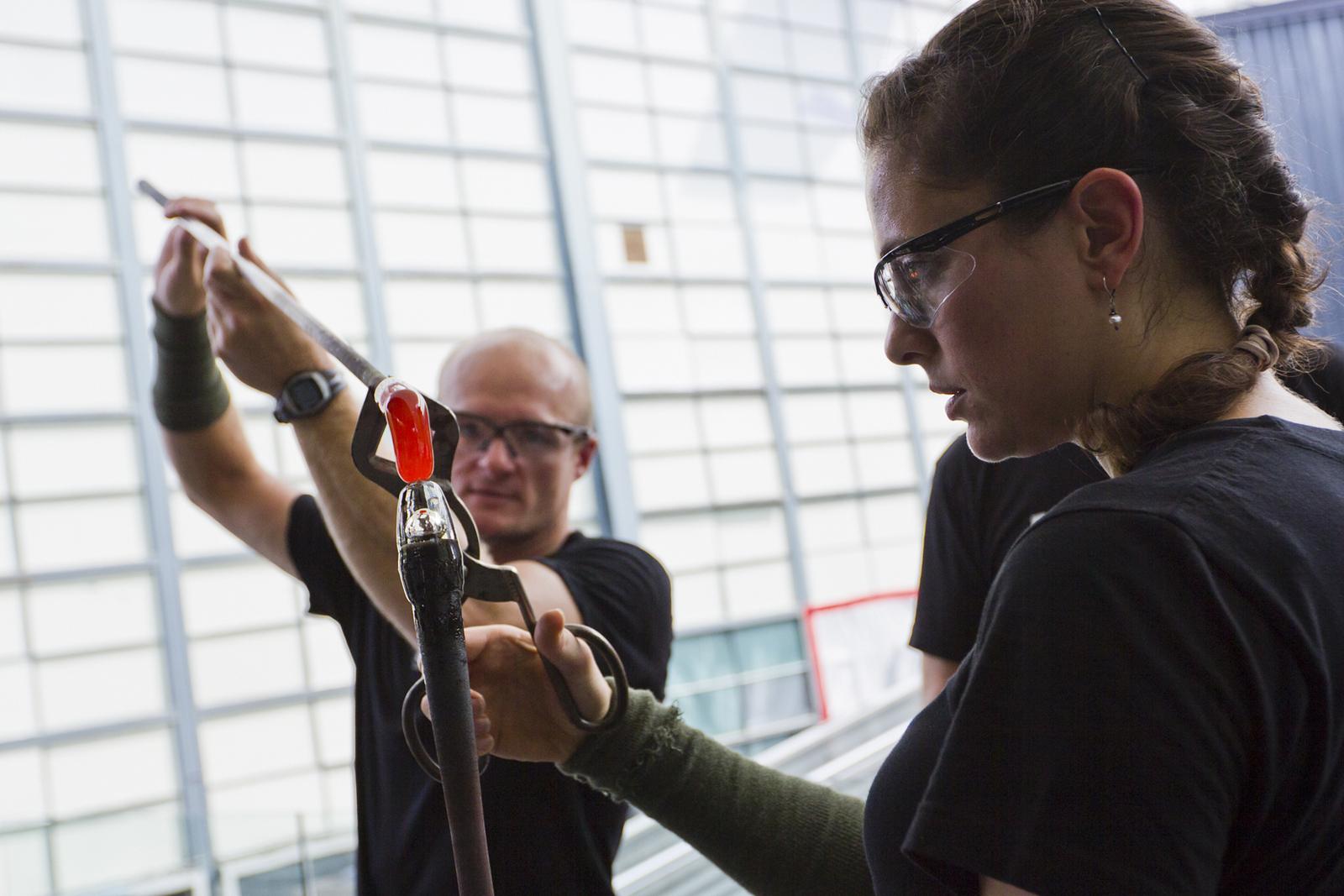 Glassmakers G Brian Juk and Annette Sheppard work with designer Jon Otis at GlassLab in Corning, July 2012