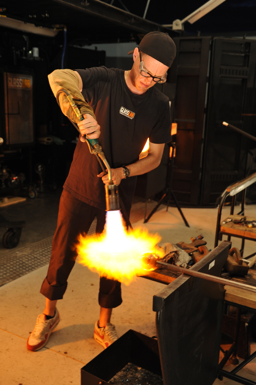 Glassmaker D.H. McNabb works on a prototype by designer Sigga Heimis at GlassLab