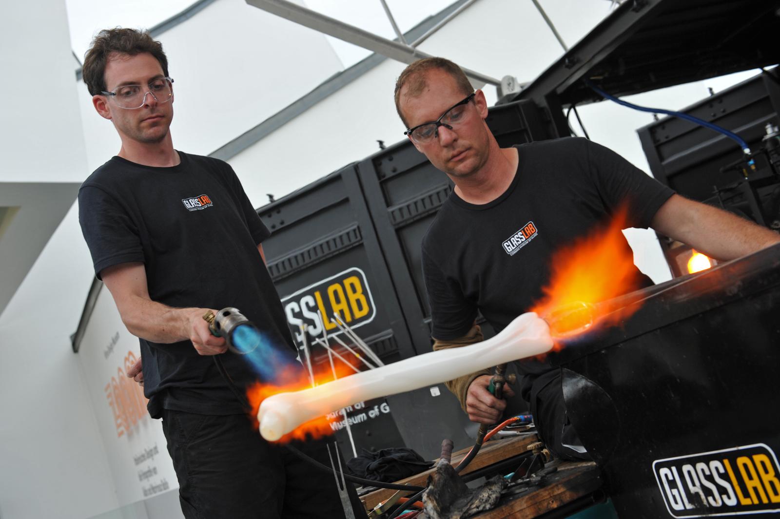 Glassmakers Dan Mirer and Eric Meek work on a design prototype by Sigga Heimis at GlassLab