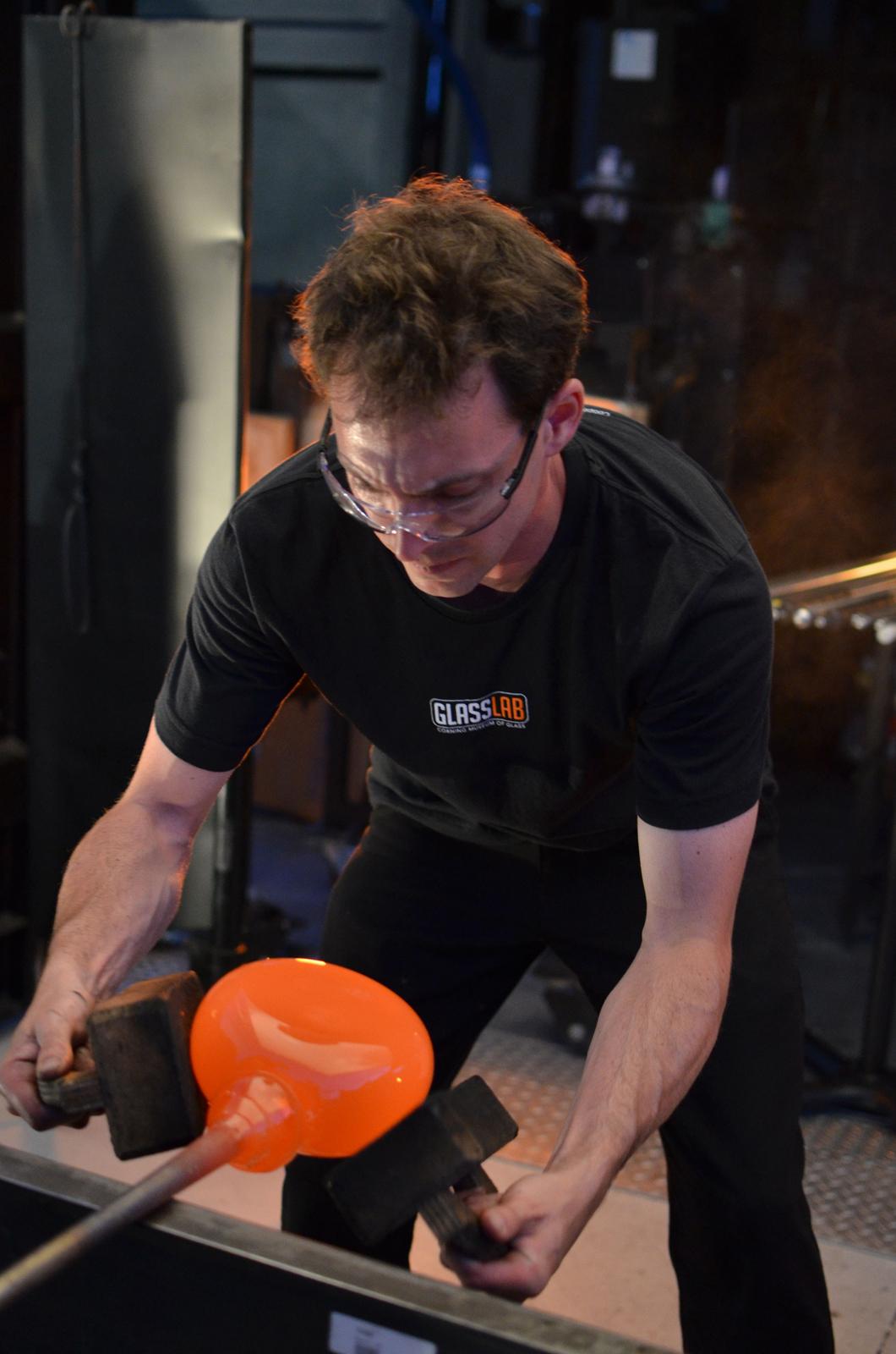 Glassmaker Dan Mirer works on a design by Sigga Heimis at GlassLab