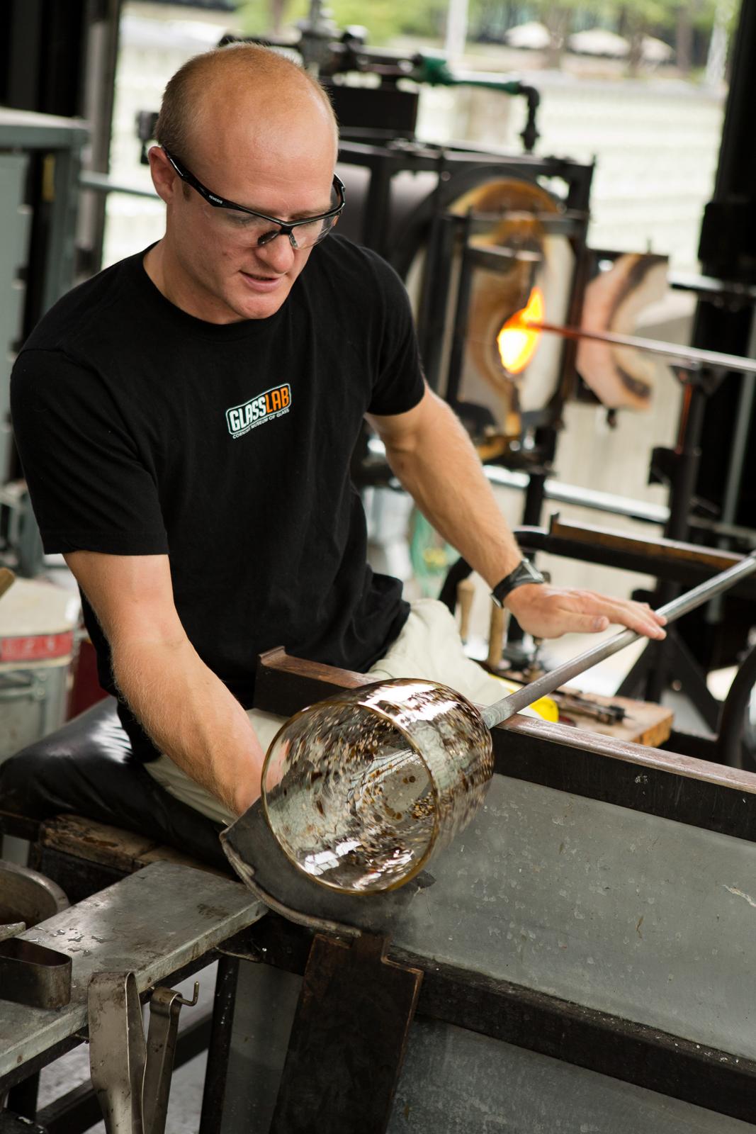 Gaffer G Brian Juk works with designer Michele Oka Doner at GlassLab in Corning, August 2012