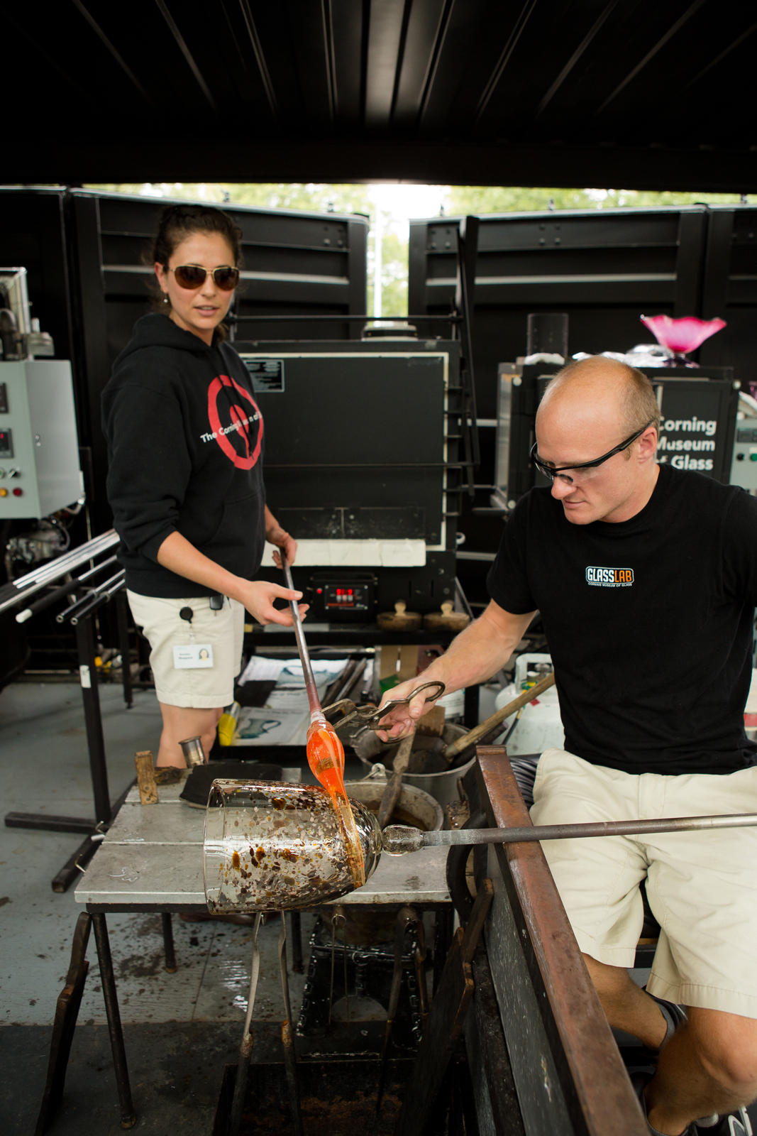 Glassmakers G Brian Juk and Annette Sheppard work with designer Michele Oka Doner at GlassLab in Corning, August 2012
