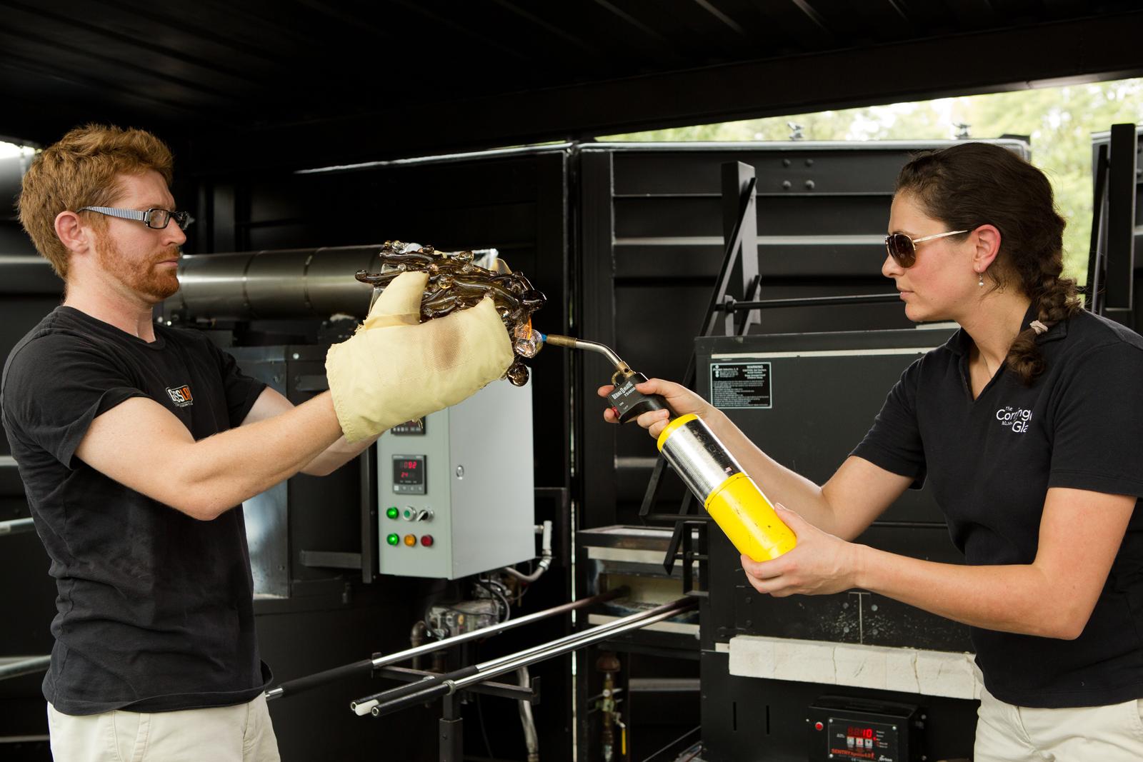 Glassmakers Dane Jack and Annette Sheppard work with designer Michele Oka Doner at GlassLab in Corning, August 2012