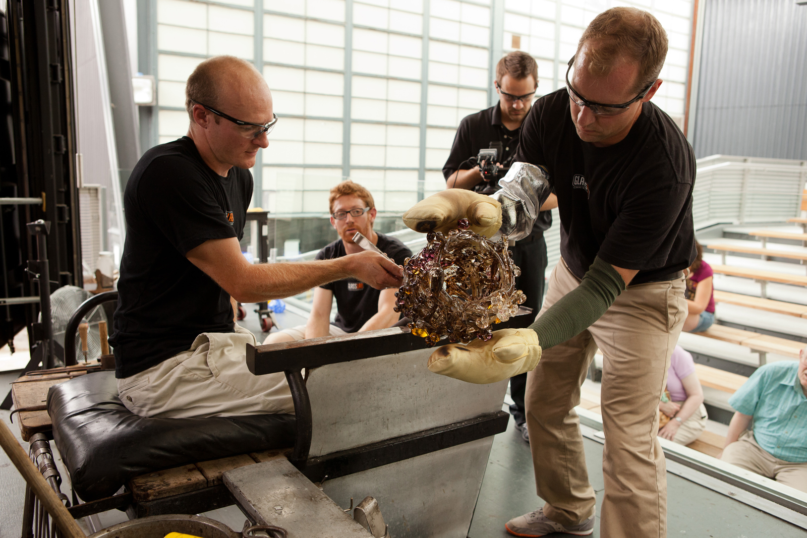 Glassmakers G Brian Juk and Eric Meek work with designer Michele Oka Doner at GlassLab in Corning, August 2012
