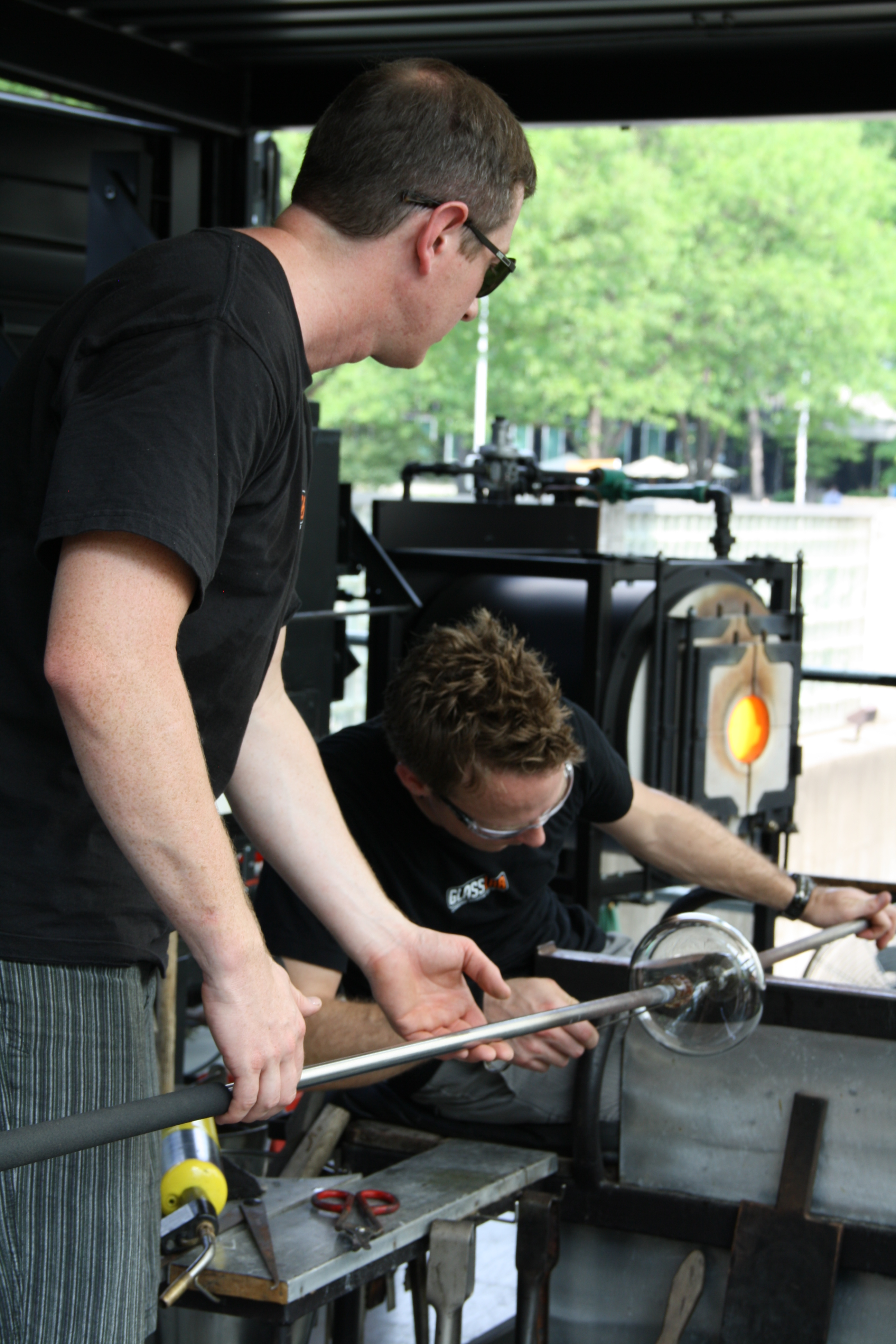 Gaffers Aaron Jack and Chris Rochelle work on a prototype designed by Josh Owen