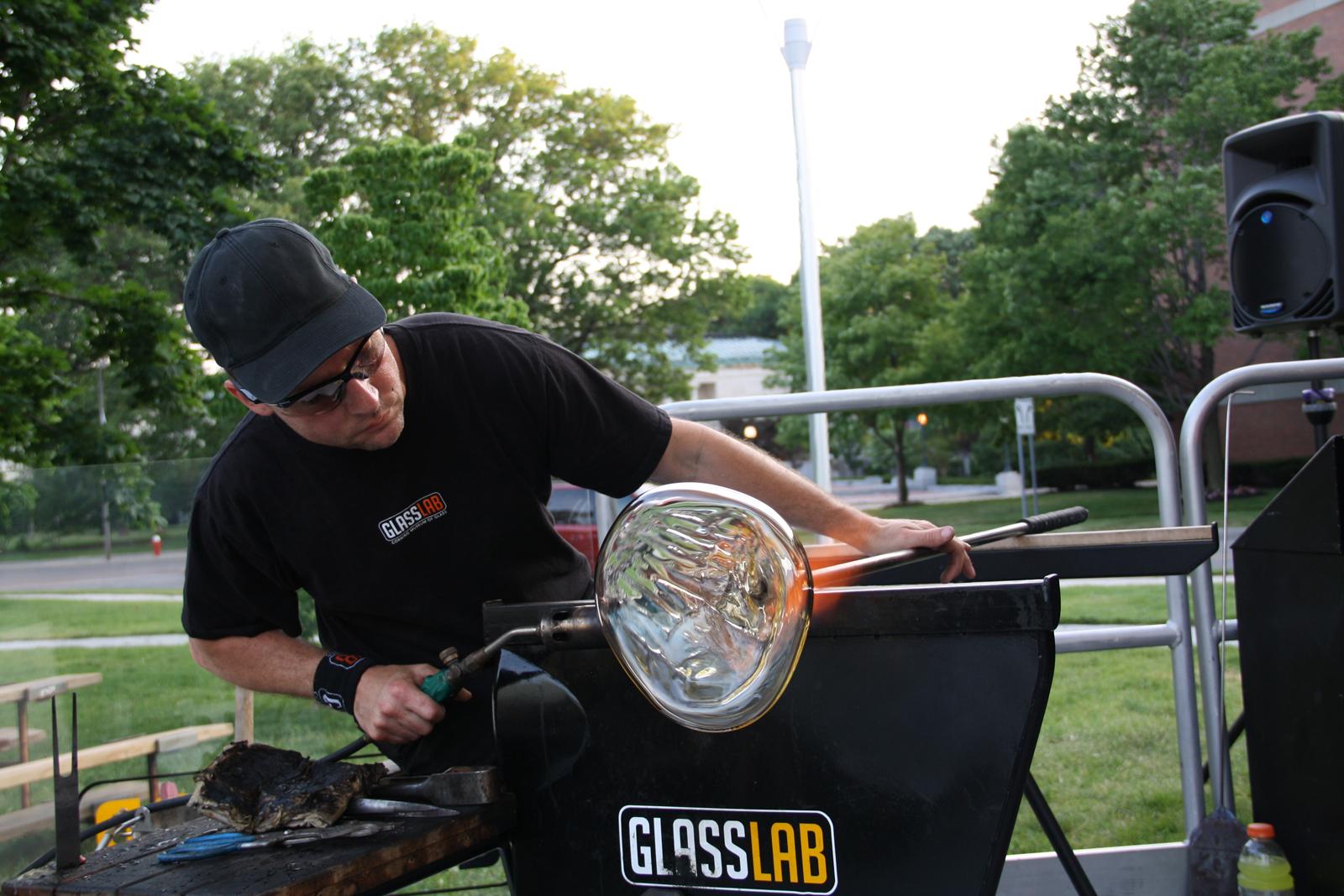Gaffer Eric Meek works on a bowl prototype by designer Harry Allen for GlassLab