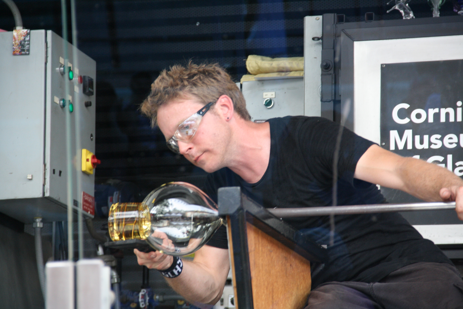 Gaffer Chris Rochelle works on a prototype by designer Judy Smilow for GlassLab at Governors Island