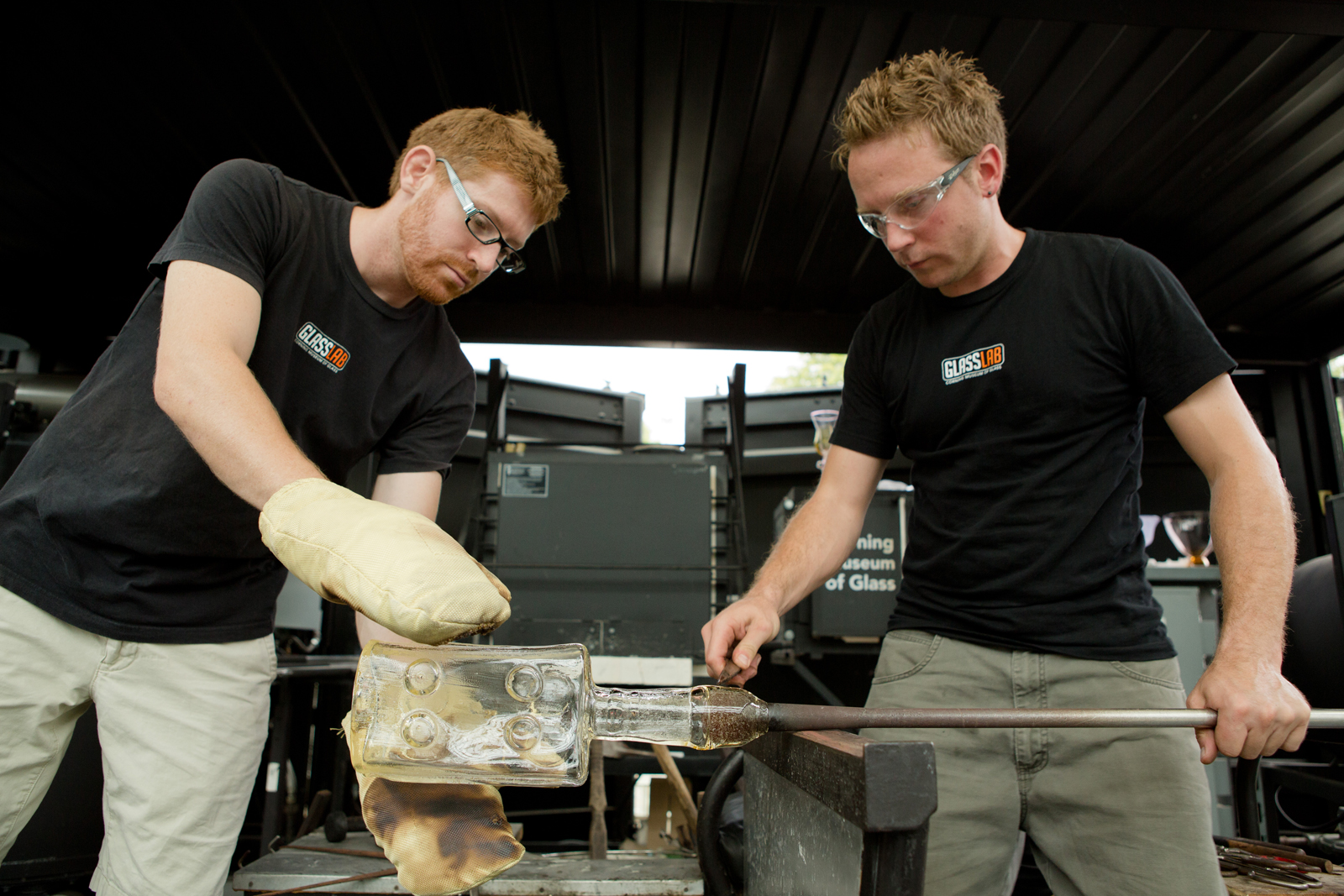 Glassmakers Dane Jack and Chris Rochelle work with Tim Dubitsky at GlassLab in Corning, August 2012