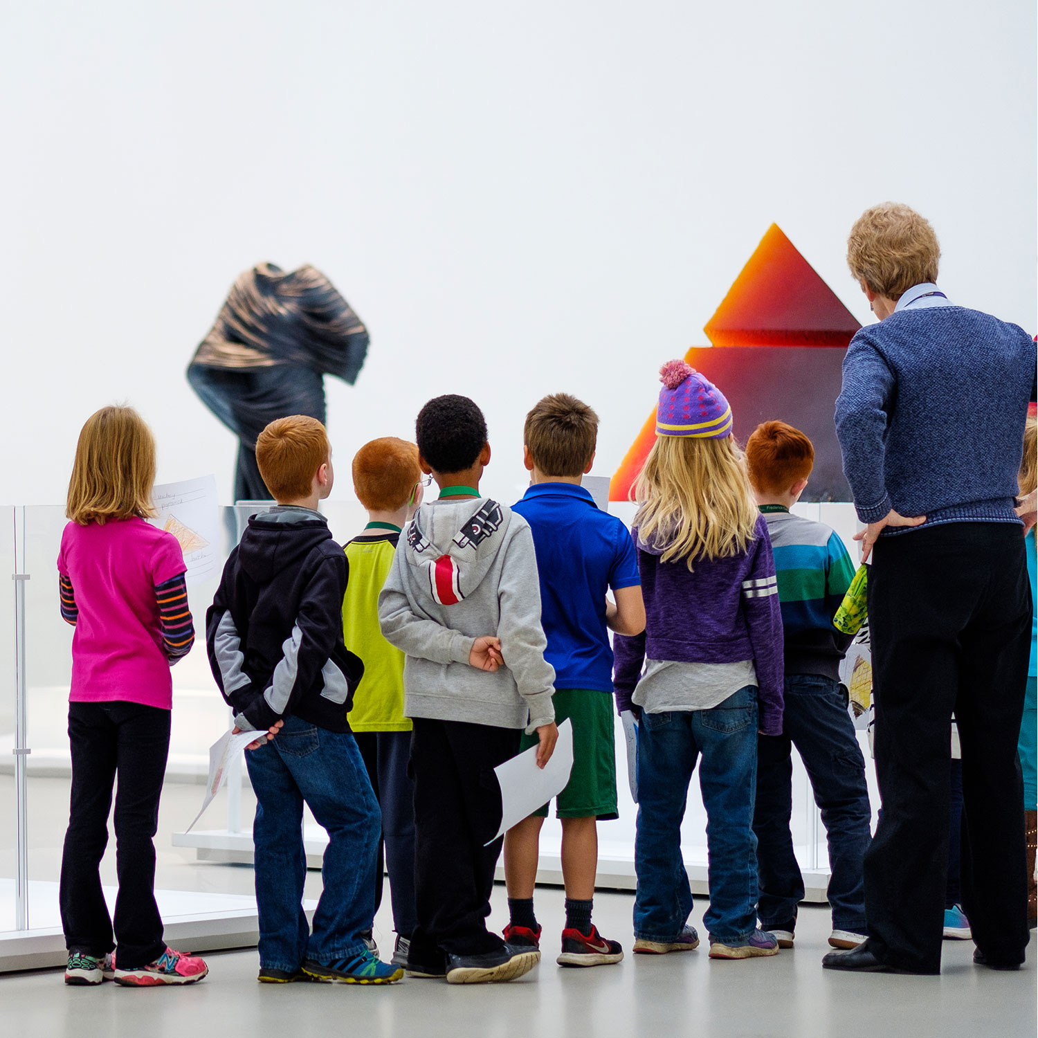 Docent giving a tour to a group of children