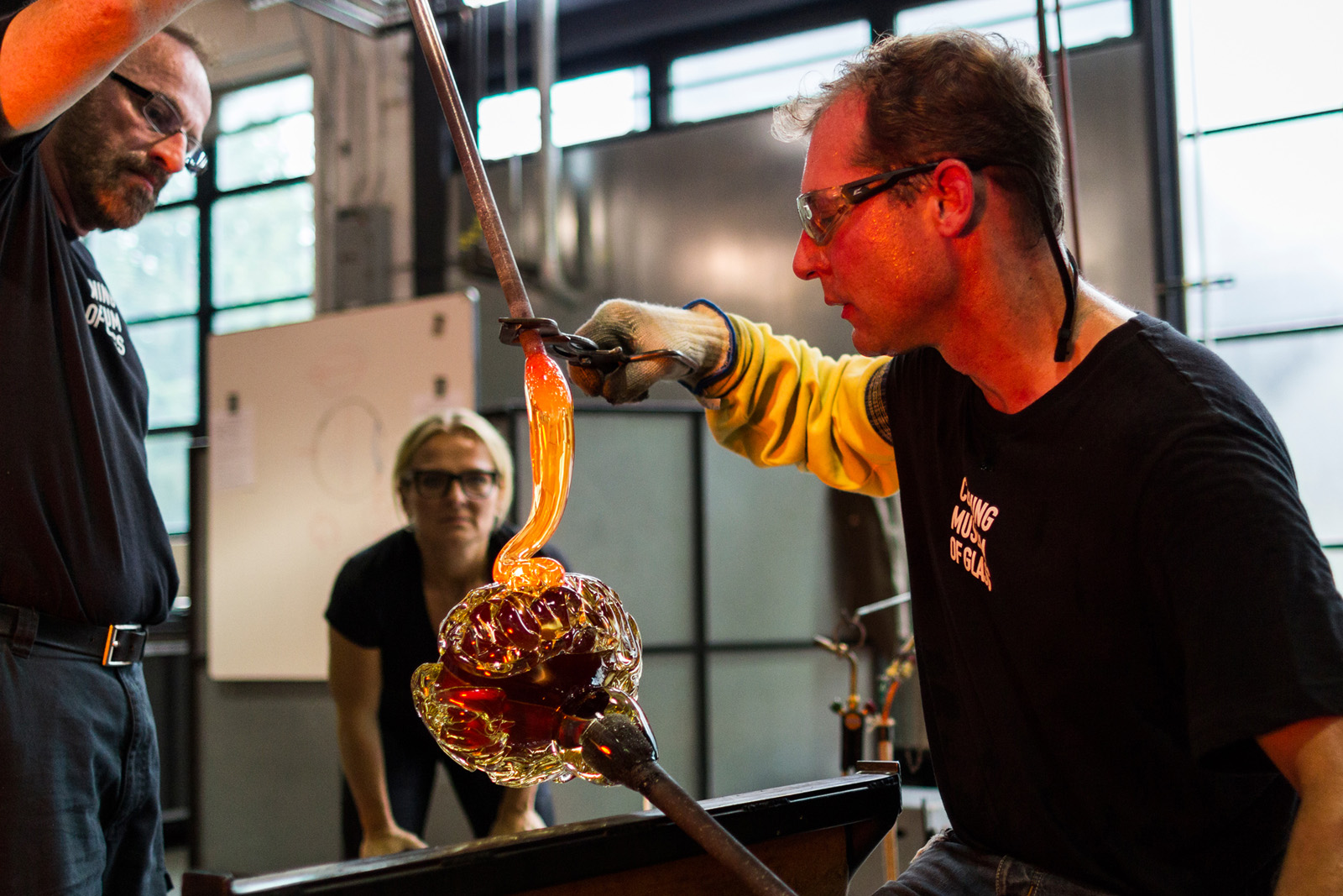 Glassmaker Eric Meek adds detail to the glass brain designed by Sigga Heimis