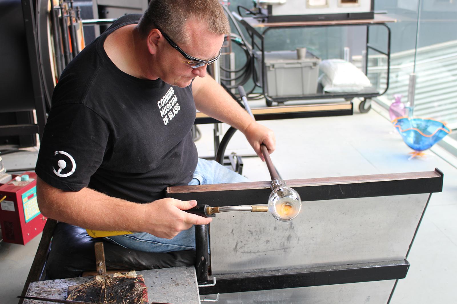 Glassmaker George Kennard works on a whiskey glass prototype by designer Bridget Sheehan at GlassLab