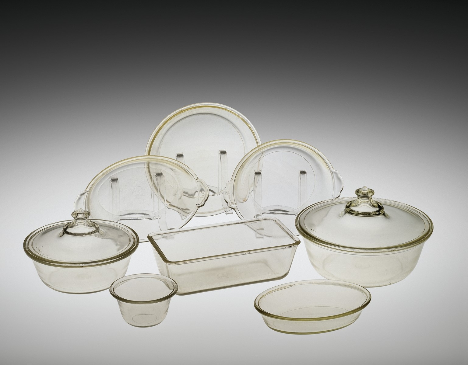 Eight of the first twelve pieces of Pyrex-brand ovenware; 2 Covered Casseroles (#101 and #103); Loaf Pan (#212); Pie Plate (#202); Shirred Egg Dish (#301); ... & All About Glass | Corning Museum of Glass
