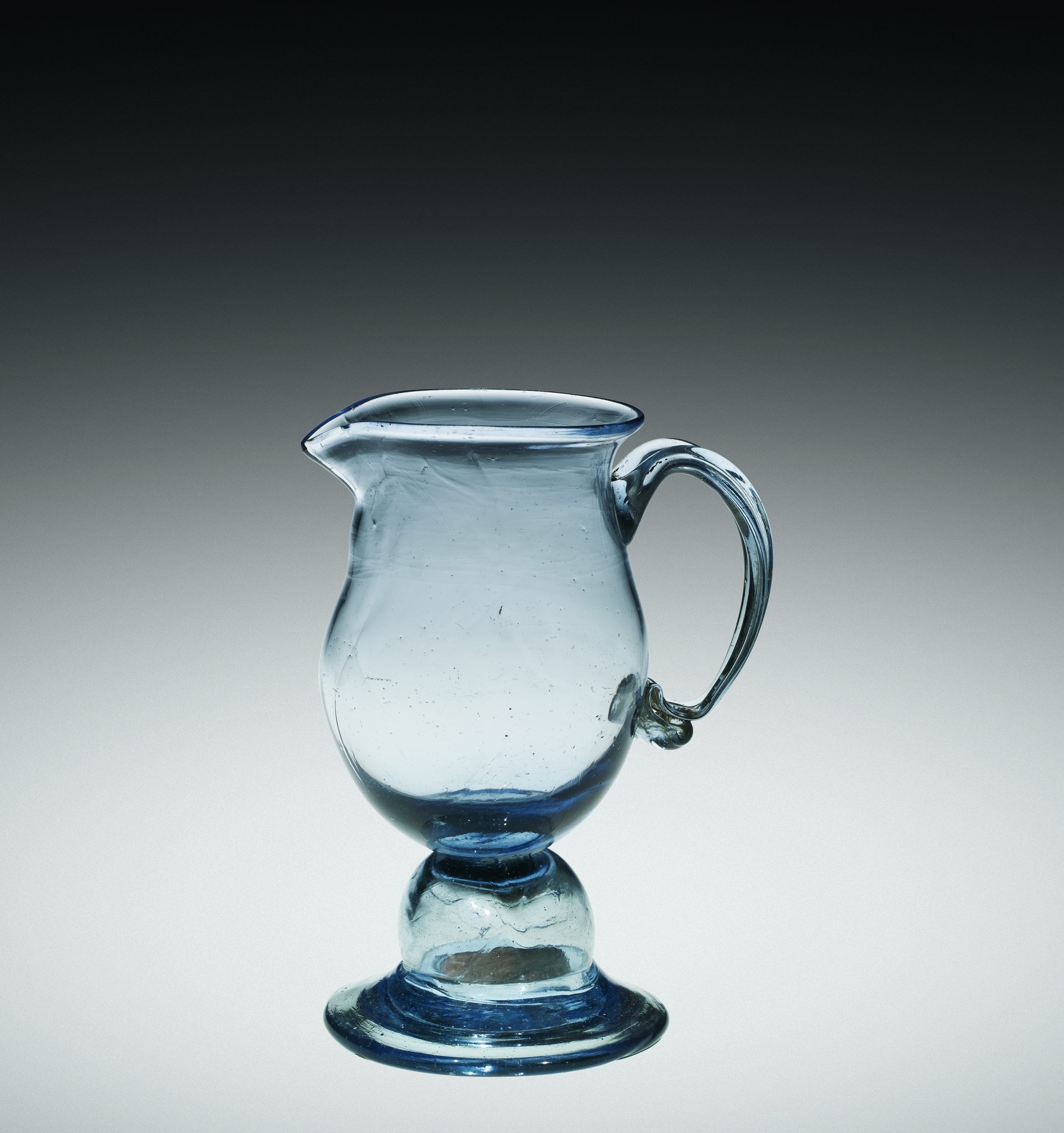 blue american glass creamer with a knop (hollow bubble in the stem) enclosing a 1794 U.S. cent coin