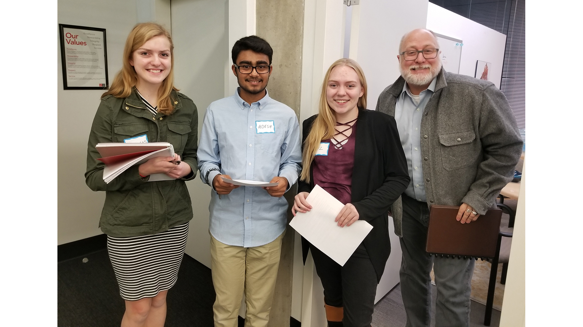 Frances Mack, Adesh Tiwari, Elizabeth Schumacher, and Troy Smythe prepare to present the Junior Curator exhibition proposal to Karol Wight, 2017