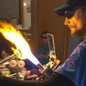 Miles Parker working at a Flamworking torch