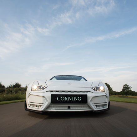 The front bumper of a white sports car.