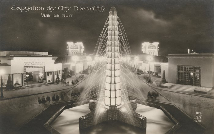 Night view of Lalique's illuminated glass fountain, called Les Sources de France (Springs of France), at the 1925 Exposition internationale des arts décoratifs et industriels modernes, Paris. Architect, Marc Ducluzaud. The Lalique pavilion appears on the right.