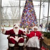 Mr. and Mrs. Claus at The Corning Museum of Glass Holiday Open House (Santa and Mrs. Claus in front of the ornament tree)