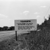 Roadside sign informing tourists of June 23rd flood damage Collection of Archives, Corning Incorporated
