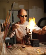 Emilio Santini working glass at a torch (photo credit: Adam Ewing)