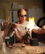 Emilio Santini working glass at a torch (photo credit: Adam Ewing)