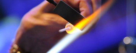 glass bead being worked in a hot flame