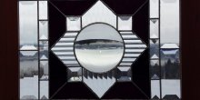 Stained glass window with black and clear geometric design
