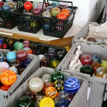 Handmade ornaments by Museum glassblowers ready to be added to the tree