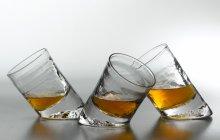 three angled glass whiskey glasses