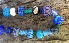Assorted Blue, white, and purple beads by Corinne Everhart