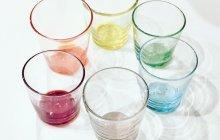Set of six colorful glass tumblers.