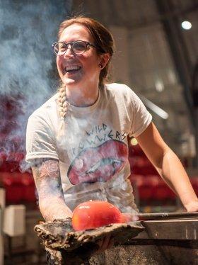 Artist Megan Stelljes at work glassblowing