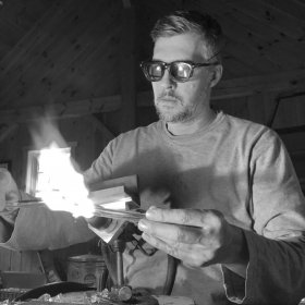 David Colton working on a piece at a flameworking torch