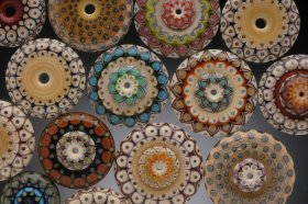 Collection of Floral Disk Beads by Kristina Logan, photo by Dean Powell