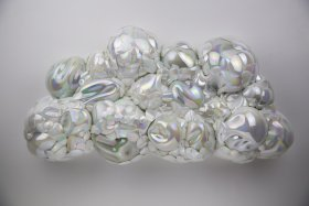Iridescence cloud shaped sculpture made from glass
