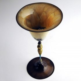 Glass goblet in golds, beiges, and bronzes