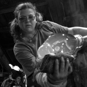 Nadine Saylor working with hot glass