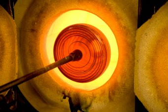 A design by Francisco Costa is reheated in the furnace at a GlassLab design performance