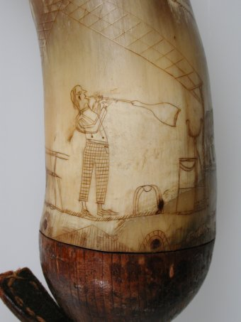 Fig. 3: Detail of powder horn showing figure of the glassblower.