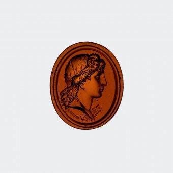 Cast Glass Gem of Apollo, James Tassie and William Tassie, England, London, 1777-1860. Cast, L. 2.75 cm, W. 1.8 cm, Depth 0.65 cm. (2013.3.8)