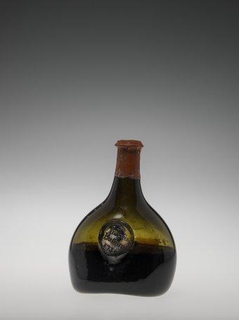 Wine Bottle  England, 1730 Non lead Glass, Liquid Wine, Lead, Foil, Paint Overall H: 18.5 cm; Base W: 10.5 cm 68.2.11