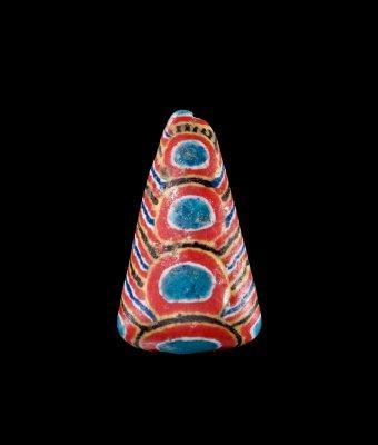 Kiffa Bead West Africa, Kiffa, Mauritania, late 20th century Opaque white, yellow, deep blue, red, black Powder glass H. 2.4 cm, W. 1.4 cm 86.3.108-1