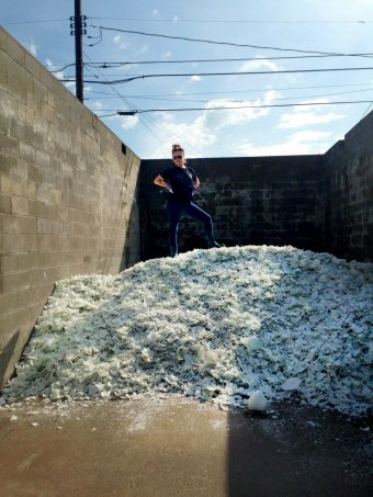 Amber Cowan on a pile of cullet in West Virginia (the beginning of the 29th Rakow Commission)